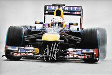 Sebastian Vettel SIGNED 12x8, F1 Red Bull RB9 . F1 Test Jerez 2013