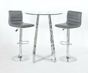 Clear Glass Round Poseur Table With Two Grey Ribble Bar Stools