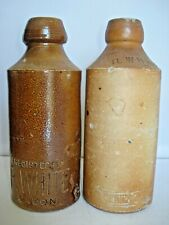 R Whites antique ginger beer stoneware bottles George & Dragon incised labels
