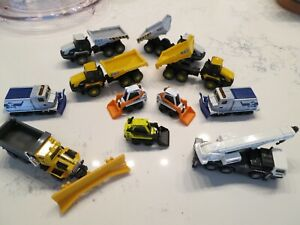 Lot of 11 vintage Matchbox Ranec, Oshkosh, JCB 726, trucks, unused in nice case.
