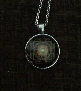 Buddhist Sri Yantra Tibetan Necklace With A Silver Coloured Chain.