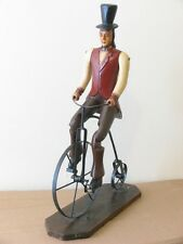 ANTIQUE LARGE WOODEN JOINTED MAN W/ TOP HAT ON METAL PENNY FARTHING BICYCLE