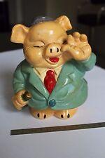 (B) Cochon tirelire