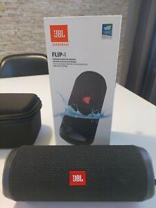 JBL Flip 4 black with additional case.