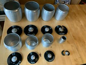 8 Piece Vintage Kromex Spun Alluminum Cannister Set