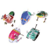 Niños juguete estaño cuerda cuerda saltando juguetes de conejo de rana de hierrK