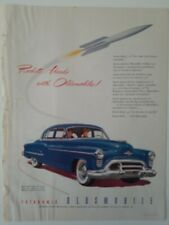 1950 blue Oldsmobile Rocket engine 98 four-door sedan car vintage original ad
