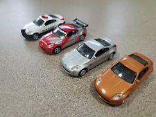 Lot (4) 1:72 Nissan Fairlady Z 350z Real-x nismo police silver burnt orange
