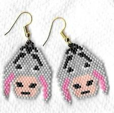 "A pair of Hand beaded Grey Eeyore Donkey head dangle earrings. 1 & 1/2"" long"