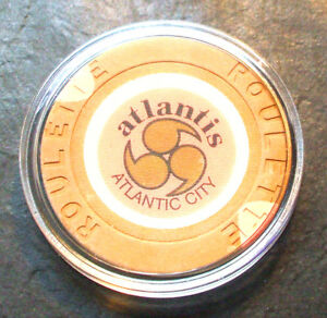 (1) Atlantis CASINO ROULETTE CHIP - 1984 - ATLANTIC CITY, New Jersey - Tan - J