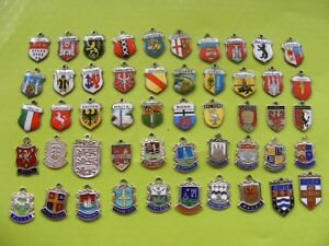 7) VARIOUS VINTAGE STERLING SILVER CHARM CHARMS UK TRAVEL SHIELD