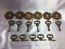 LOT OF ANTIQUE BRASS DRAWERS PULLS WITH STAMPED ROSSETTES