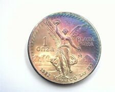 MEXICO 1982-MO .999 SILVER ONZA EXCEPTIONAL UNCIRCULATED IRIDESCENT