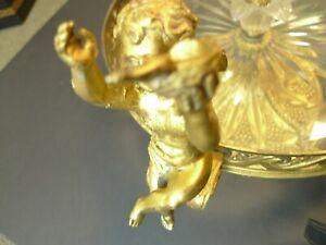 Antique centerpiece golden candlestick in the center