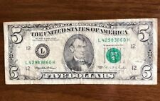 $5 dollar bill 1995 L/H series Federal Reserve Note L42983860H