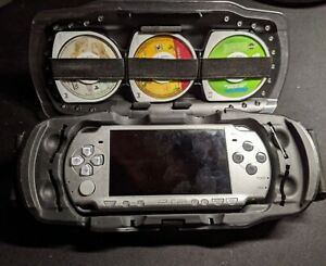 Sony PSP 2001 Bundle w/3 games, 1 movie, hard shell case and 2 memory cards
