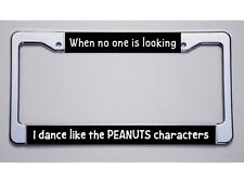 """WHEN NO ONE IS LOOKING/I DANCE LIKE THE PEANUTS CHARACTERS"" LICENSE PLATE FRAME"