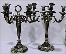 Paire de chandeliers en bronze argenté, Hauteur : 34 cm.