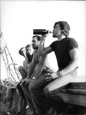 Alain Delon drinking wine, with Joanna Shimkus, Serge Reggiani and Lino Ventura