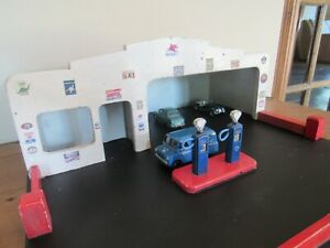 Vintage wooden toy garage with petrol pumps suitable for displaying Dinky /Corgi