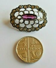 Antique silver brooch amethyst style stone surrounded by clear sparkling stones.