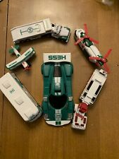 Assortment Of Toy Hess Trucks