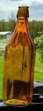 "Orange colored glass 1 quart bottle, molded, 11 7/8"" tall, 32 oz."