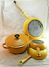 Le Creuset cookware set in Yellow, dutch oven/casserole, 2 small pans, 1 large