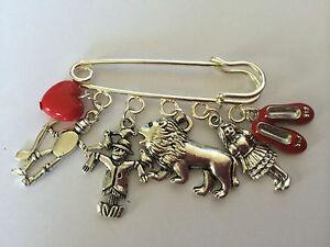 Silver Tone  KILT PIN WIZARD  OZ  Dorothy Tin Man Lion Scarecrow Red Shoe