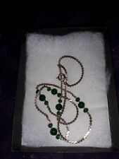 green gems. 16ins. Used condition Costume jewellery necklace, gold colour and