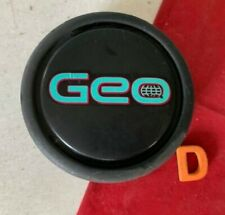 #G (1) 89 - 97  GEO TRACKER CENTER CAP blue logo 43252-56B00