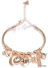 GUESS Jeans  Bangle Bracelet Rose gold Tone Charms Rhinestones Logo NWT Cuff