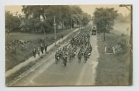 AIR VIEW OF WWI SOLDIERS ON PARADE THROUGH SMALL TOWN DIRT ROAD - RPPC - E