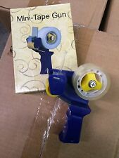 MINI PACKING TAPE DISPENSER GUN holds REGULAR HOUSEHOLD TAPE NIB TAPE INCLUDED