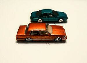 Jada Toys 1990 Lincoln Town Car with Impala SS real rubber tire tread