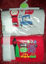 Baby Boys 2 Pack Red multi Coloured Pyjamas with Car / Driving Detail size 9-12