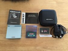 Gameboy Advance SP in Arctic Blue and 2x Games
