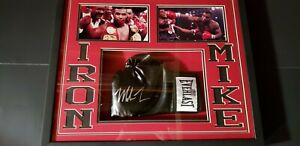 Mike Tyson signed/framed boxing glove, shadow box display.