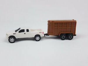 Ertl Collect and play Ford F150 pickup truck with trailer