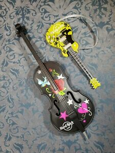 LOT OF BARBIE SIZED HARD ROCK CAFE MUSIC INSTRUMENTS BASS AND ELECTRIC GUITAR.