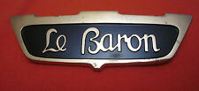 "VINTAGE CHRYSLER ""LE BARON"" NAMEPLATE. 4"" X 1.25"". USED."