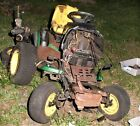 Pile of John Deere L130 riding mower parts mostly disassembled,no engine,no deck