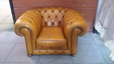 A Tanny/Gold Leather Chesterfield Club/Armchair