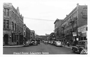 Lewiston ID Street Scene Golden Rule Sign Bank Storefronts Old Cars RPPC