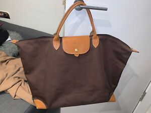 longchamp large brown zip up travel bag