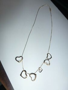 14KT SOLID YELLOW GOLD CHAIN AND SIX FLOATING HEARTS ALL HALLMARKED14KT 2.2GRAMS