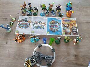 4 Jeux Skylanders  sur Wii  + 25 figurines