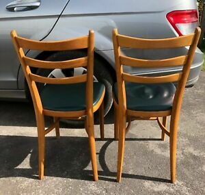 A pair of vintage bentwood kitchen chairs
