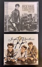 Autographed Jonas Brothers Lines, Vines, And Trying Times & Nick Jonas Who I Am