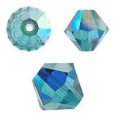 Swarovski Crystal Bicone Indicolite AB. 6mm. Approx. 48 PCS. 5328